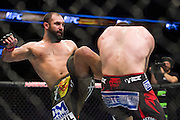 DALLAS, TX - MARCH 14:  Johny Hendricks kicks Matt Brown during UFC 185 at the American Airlines Center on March 14, 2015 in Dallas, Texas. (Photo by Cooper Neill/Zuffa LLC/Zuffa LLC via Getty Images) *** Local Caption *** Johny Hendricks; Matt Brown
