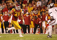 25 OCTOBER 2008: Iowa State defensive tackle Stephen Ruempolhamer (97) and Iowa State defensive end Kurtis Taylor (47) close in on Texas A&M quarterback Jerrod Johnson (1) in the first half of an NCAA college football game between Iowa State and Texas A&M, at Jack Trice Stadium in Ames, Iowa on Saturday Oct. 25, 2008. Texas A&M beat Iowa State 49-35.