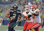 Aug 25, 2017; Seattle, WA, USA; Seattle Seahawks quarterback Russell Wilson (3) is pressured by Kansas City Chiefs defensive end Allen Bailey (97) and outside linebacker Dee Ford (55) during a NFL football game at CenturyLink Field.