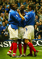Fotball<br /> Premier League England 2004/2005<br /> 18.10.2004<br /> Foto: BPI/Digitalsport<br /> NORWAY ONLY<br /> <br /> Portsmouth v Tottenham Hotspur<br /> <br /> Ayegbeni Yakubu celebrates heading in the opener for Portsmouth with Lomana Lua Lua and Andy Griffin