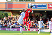 Vadaine Oliver wins a header during the Friendly match between York City and Leeds United at Bootham Crescent, York, England on 15 July 2015. Photo by Simon Davies.