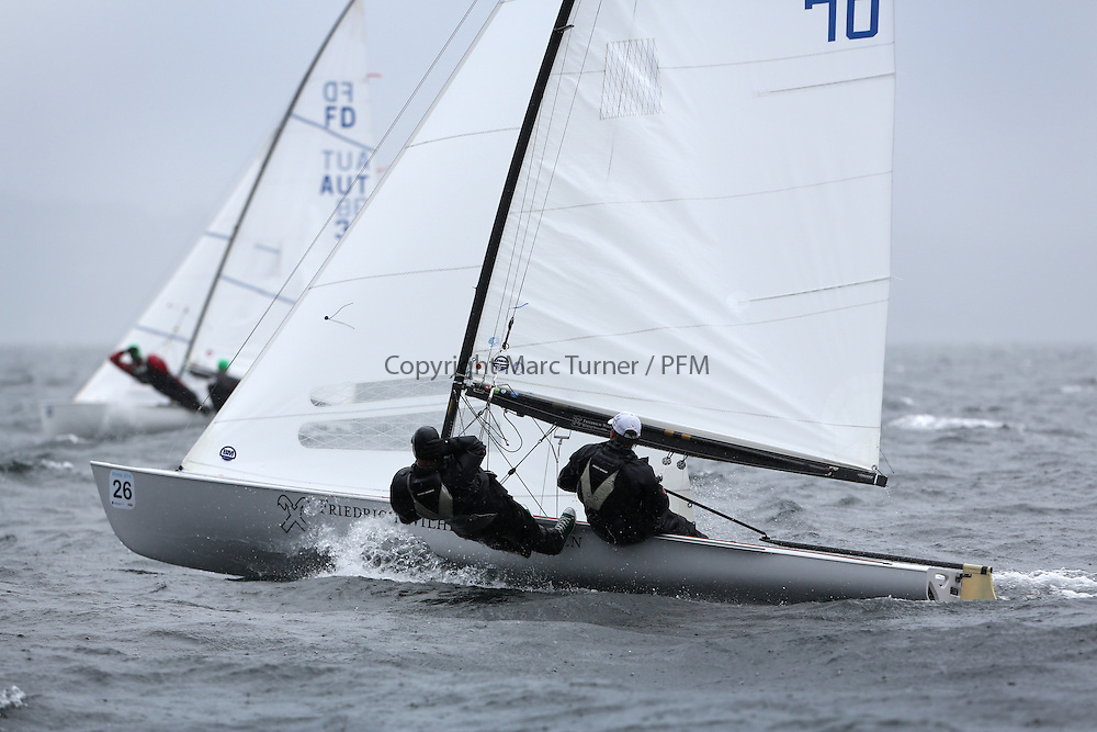 The Flying Dutchman World Championships,  Largs 2014. First days racing in breezy conditions on the Clyde. <br /> <br /> Fleet of FD's sailing downwind with<br /> Hungarians, HUN 70,  Szabolcs Majth&eacute;nyi and Andr&aacute;s Domokos<br /> <br /> <br /> The former Olympic class has attract 40 worldwide competitors to Scotland to compete. <br /> <br /> PIctures Marc Turner / PFM Pictures