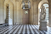 Entrance hall of the Chateau de Champlatreux, built 1751-57 by Jean-Michel Chevotet, Epinay-Champlatreux, Val-d'Oise, France. Image taken from the filming of 'Paris la ville a remonter le temps' written by Carlo de Boutiny and Alain Zenou, directed by Xavier Lefebvre, a Gedeon Programmes production. The chateau was listed as a Historic Monument in 1989. Picture by Manuel Cohen