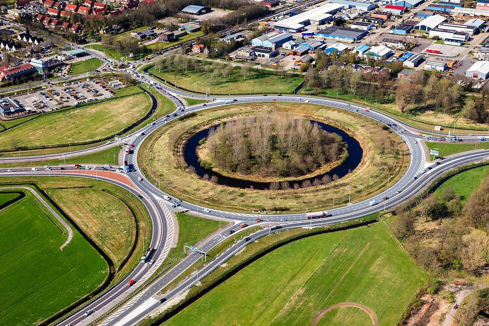 Nederland, Friesland, Gemeente Skarsterlan (Scharsterland), 01-05-2013; knooppunt Joure met A7 naar Sneek / Afsluitdijk (links midden), A7 richting Heerenveen / Groningen (rechts) en de A6 richting Lemmer / Noordoostpolder (onder). Boven links afslag Joure en bebouwde kom Joure.<br /> <br /> luchtfoto (toeslag op standard tarieven)<br /> aerial photo (additional fee required)<br /> copyright foto/photo Siebe Swart
