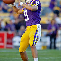 October 16, 2010; Baton Rouge, LA, USA; LSU Tigers quarterback T.C. McCartney (8) during warm ups prior to kickoff against the McNeese State Cowboys at Tiger Stadium. LSU defeated McNeese State 32-10. Mandatory Credit: Derick E. Hingle