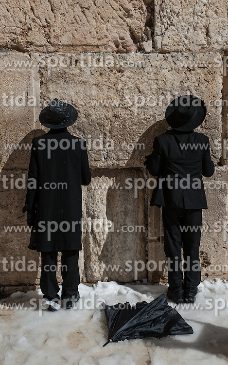 Ultra-Orthodox Jewish men pray at the snow-covered Western Wall in the Old City of Jerusalem, on Feb. 20, 2015. Some parts of Israel were covered with snow early Friday amid a heavy winter storm and extreme weather conditions. Snow piled up to unusual heights of about 25 cm in Jerusalem, according to a statement by the municipality. Highways to Jerusalem were shut down and residents of the city have been asked not to travel unnecessarily. The municipality said 250 snow ploughs have been operating in order to keep the main roads in the city leading to the major hospitals open. EXPA Pictures &copy; 2015, PhotoCredit: EXPA/ Photoshot/ Li Rui<br /> <br /> *****ATTENTION - for AUT, SLO, CRO, SRB, BIH, MAZ only*****