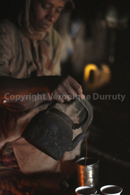 COFFEE CEREMONY IN A HOUSE OF SIMIEN MOUNTAINS, ETHIOPIA