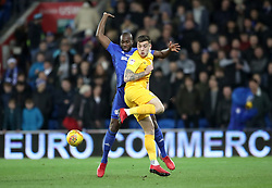 Preston North End's Jordan Hugill and Cardiff City's Sol Bamba (left) battle for the ball during the Sky Bet Championship match at The Den, London.