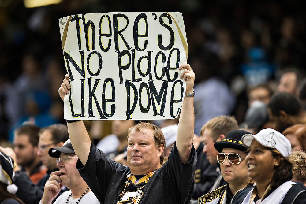 NEW ORLEANS, LA - DECEMBER 8: Fan of the New Orleans Saints holds up a sign during a game against the Carolina Panthers at Mercedes-Benz Superdome on December 8, 2013 in New Orleans, Louisiana.  The Saints defeated the Panthers 31-13.  (Photo by Wesley Hitt/Getty Images) *** Local Caption ***