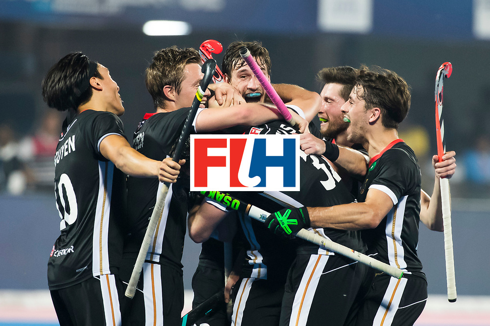 BHUBANESWAR - Hockey World League finals Match for bronze , Germany v India (1-2).  Mark Appel (Ger) scored . middle Florian Fuchs (Ger) and Niklas Bruns (Ger). COPYRIGHT KOEN SUYK