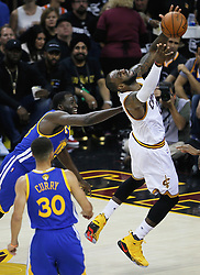 The Cleveland Cavaliers' LeBron James, right, is fouled by the Golden State Warriors' Draymond Green in the first quarter during Game 4 of the NBA Finals at Quicken Loans Arena in Cleveland on Friday, June 9, 2017. (Photo by Leah Klafczynski/Akron Beacon Journal/TNS) *** Please Use Credit from Credit Field ***