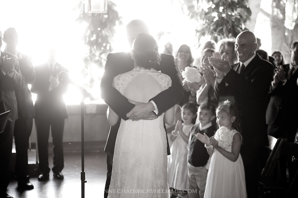 A bride and groom kiss during their wedding at Berkeley City Club.
