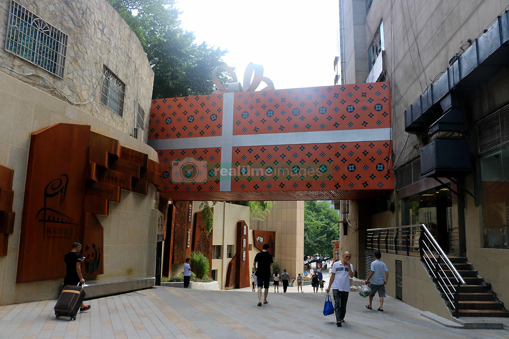 August 17, 2017 - Chongqing, Chongqing, China - Chongqing, CHINA-15th August 2017: (EDITORIAL USE ONLY. CHINA OUT) ..The giant gift box shaped Internet cafe can be seen 10 meters above the ground in southwest China's Chongqing. (Credit Image: © SIPA Asia via ZUMA Wire)