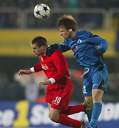 SOFIA, BULGARIA - Wednesday, March 3, 2004: Liverpool's Michael Owen and Levski Sofia's Elin Topuzakov during the UEFA Cup 4th Round 2nd Leg match at the Vasil Levski Stadium, Sofia, Bulgaria. Wednesday, March 3rd, 2004...Picture by David Rawcliffe/Propaganda..Any problems please call David Rawcliffe on 07973 14 2020 or email david@propaganda-photo.com.