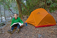 Reading the topo map at camp, Sykes Hot Springs, Big Sur, California.
