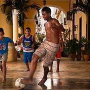 CUBA (La Habana). 2009. Children playing football in Plaza Vieja of La Habana.