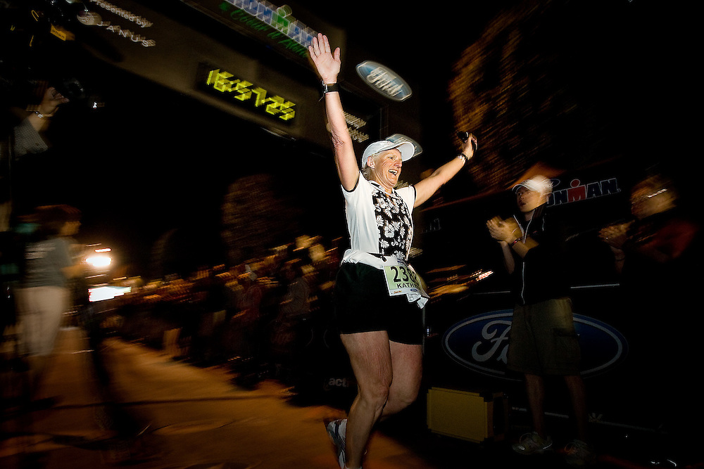 JEROME A. POLLOS/Press..Kathryn Curl, from Idaho Falls, crosses the finish line Sunday as the last triathlete to complete the Ford Ironman Coeur d'Alene before the 17-hour cutoff time. Curl, 64, finished with a time of 16:57:24 and was the 1,942 person to complete the 2008 Ford Ironman Coeur d'Alene.