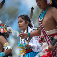 Talia Wallace performs with the Kallestewa dance group at the Zuni Main Street Festival in Zuni Saturday.