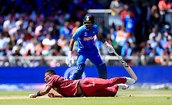 West Indies' Oshane Thomas attempts to catch India's MS Dhoni out during the ICC Cricket World Cup group stage match at Emirates Old Trafford, Manchester.