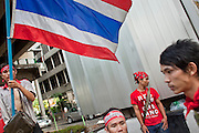 """Apr 4, 2010 - BANGKOK, THAILAND: A Red Shirt roadblock in the commercial center of Bangkok, Thailand. Thousands of members of the United Front of Democracy Against Dictatorship (UDD), also known as the """"Red Shirts"""" and their supporters moved their anti government protests into central Bangkok Apr. 4 when they occupied Ratchaprasong intersection, the site of Bangkok's fanciest shopping malls and several 5 star hotels. The Red Shirts are demanding the resignation of current Thai Prime Minister Abhisit Vejjajiva and his government. The protest is a continuation of protests the Red Shirts have been holding across Thailand. They support former Prime Minister Thaksin Shinawatra, who was deposed in a coup in 2006 and went into exile rather than go to prison after being convicted on corruption charges. Thaksin is still enormously popular in rural Thailand. This move, away from their traditional protest site in the old part of Bangkok, has gridlocked the center of the city and closed hundreds of stores and restaurants and several religious shrines. There has not been any violence, but the government had demanded that the Red Shirts return to the old part of the city.   PHOTO BY JACK KURTZ"""