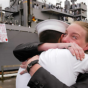E-5 Robert Kovacs surprises Shannon Duffee with marriage proposal after his ship the U.S.S. Bridge docks in Bremerton, Washington.