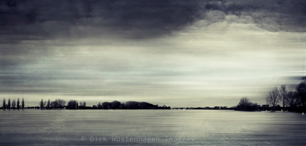 Panorama of the flooded meadows of river Rhine in early 2011 - texturized and digitally photographs.