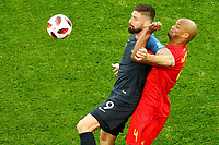 SAINT PETERSBURG, RUSSIA - JULY 10: Olivier Giroud (L) of France national team and Vincent Kompany of Belgium national team vie for the ball during the 2018 FIFA World Cup Russia Semi Final match between France and Belgium at Saint Petersburg Stadium on July 10, 2018 in Saint Petersburg, Russia. MB Media