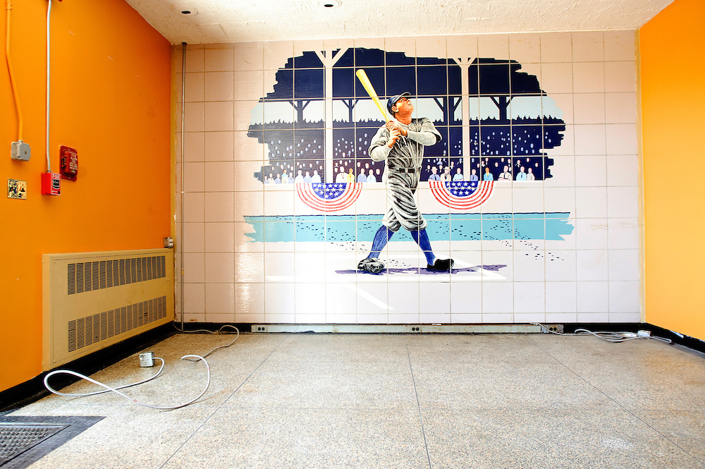 "(photo by Matt Roth).Wednesday, April 14, 2010.Assignment ID: 30095570A..The tiled Babe Ruth Mural on display inside the Cardinal Gibbons High School Athletic Center will be dismantled when the school shuts its doors at the end of this school year..The Archdiocese of Baltimore announced thirteen Catholic Schools will close at the school year's end, including Cardinal Gibbons High School. The site, formerly known as St. Mary's Industrial School, a school for ""wayward boys,"" was where Babe Ruth played while in high school. The shutting has left the baseball diamond's future susceptible to sale and development."