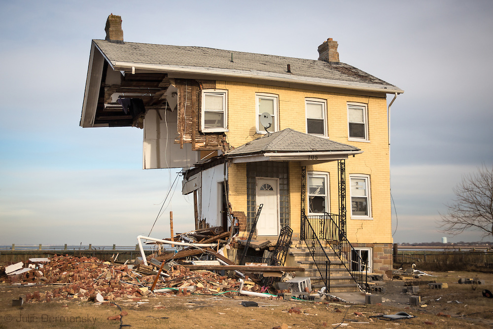 Union Beach NJ, November 16, A home  cut in half by superstorm Sandy stands  on the waterfront after a surge hit the city causing massive destruction. Hurricane Sandy caused billions of dollars of damage. The superstorm is being blamed on climate change by many scientists.