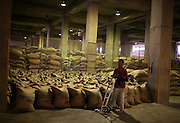 An Ethiopian worker prepares 100 kilo bags of export quality green coffee beans for distribution in the giant warehouse of the Keffa Export Coffee Processing Plant February 21, 2007 in Addis Ababa, Ethiopia.  Ethiopia exports more than 120,000 metric tons of green coffee beans per year, and one in four Ethiopians is employed within the coffee business.