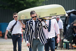 © Licensed to London News Pictures. 04/07/2018. Henley-on-Thames, UK. Rowers form Oxford University Lightweight Rowing Club carry their boat on Day one of the Henley Royal Regatta, set on the River Thames by the town of Henley-on-Thames in England. Established in 1839, the five day international rowing event, raced over a course of 2,112 meters (1 mile 550 yards), is considered an important part of the English social season. Photo credit: Ben Cawthra/LNP