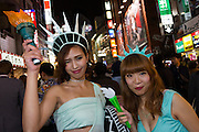 Two Japanese women, dressed as the Statue of Liberty during the Halloween celebrations in Shibuya, Tokyo, Japan. Saturday October 29th 2016 Halloween celebration in Japan have grown massively in the last few years. To ensure the safety of the crowds in Shibuya this year, the police closed several roads leading to the famous Hachiko Square, allowing costumed revellers to spread over a larger area.