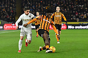 Leeds United midfielder Pablo Hernandez (19) and Hull City defender Ola Aina (34) during the EFL Sky Bet Championship match between Hull City and Leeds United at the KCOM Stadium, Kingston upon Hull, England on 30 January 2018. Photo by Ian Lyall.
