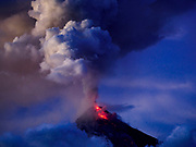 25 JANUARY 2018 - DARAGA, ALBAY, PHILIPPINES:  The cone of the Mayon volcano seen during an eruption Thursday night as seen from the town of Daraga. The Mayon volcano continued to erupt Thursday. The airport in Legazpi is closed until at least 31 January 2018. More than 60,000 people have been evacuated because of the volcano.    PHOTO BY JACK KURTZ