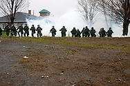 During the Quebec Liberal Party annual convention, riot police of the Sureté du Québec begin a charge against student demonstrators amid a cloud of tear gas. Victoriaville, Québec, May 4, 2012.