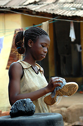 GHANA,Accra,Kokomlemle, 2007. A girl prepares for school after the Independence Day holiday. Many Ghanaians marked the day with joy.