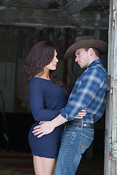 sexy cowboy couple on a ranch