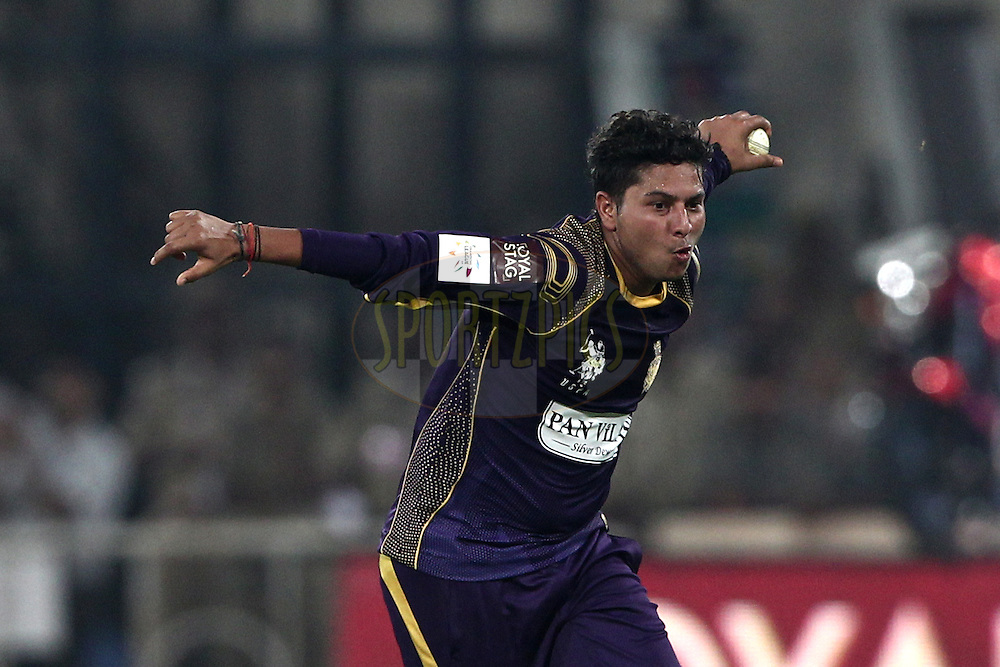 Kuldeep Singh Yadav of the Kolkata Knight Riders celebrates the wicket of  Nathan Coulter-Nile of Perth Scorchers during match 10 of the Oppo Champions League Twenty20 between the Kolkata Knight Riders and the Perth Scorchers held at the Rajiv Gandhi Cricket Stadium, Hyderabad, India on the 24th September 2014<br /> <br /> Photo by:  Deepak Malik / Sportzpics/ CLT20<br /> <br /> <br /> Image use is subject to the terms and conditions as laid out by the BCCI/ CLT20.  The terms and conditions can be downloaded here:<br /> <br /> http://sportzpics.photoshelter.com/gallery/CLT20-Image-Terms-and-Conditions-2014/G0000IfNJn535VPU/C0000QhhKadWcjYs