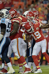 Aug 28, 2015; Kansas City, MO, USA; Kansas City Chiefs tight end Travis Kelce (87) is congratulated by wide receiver Jeremy Maclin (19) after scoring during the first half against the Tennessee Titans at Arrowhead Stadium. Mandatory Credit: Denny Medley-USA TODAY Sports