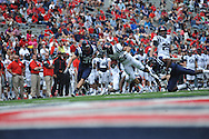 Nathan Vanderburg (33) is tackled by David Kamara (29) during Mississippi's Grove Bowl controlled scrimmage at Vaught-Hemingway Stadium in Oxford, Miss. on Saturday, April 5, 2014.