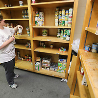 Susan Gilbert, Social Services Program Coordinator for the Salvation Army in Tupelo, organizes and straightens up what can goods she has left inside the food pantry Wednesday morning at the Salvation Army.