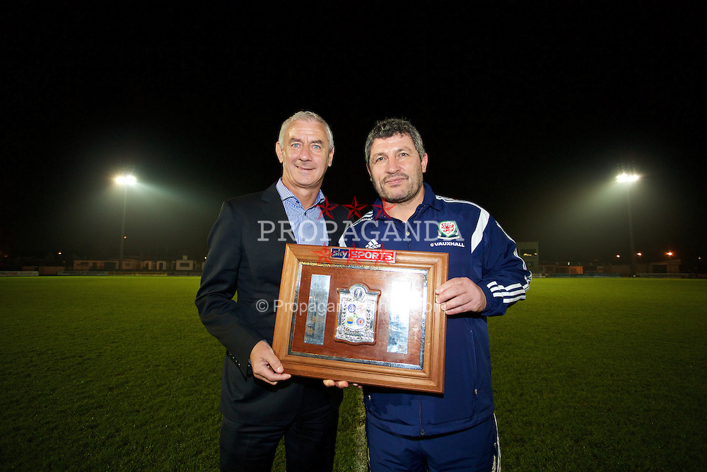 BALLYMENA, NORTHERN IRELAND - Thursday, November 20, 2014: Wales' Ian Rush and Osian Roberts with the Victory Shield after a 2-0 win over Northern Ireland during the Under-16's Victory Shield International match at the Ballymena Showgrounds. (Pic by David Rawcliffe/Propaganda)