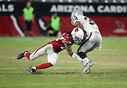 Oakland Raiders defensive back Dewey McDonald (35) gets tackled b Arizona Cardinals rookie cornerback Harlan Miller (34) during the 2016 NFL preseason football game against the Arizona Cardinals on Friday, Aug. 12, 2016 in Glendale, Ariz. The Raiders won the game 31-10. (©Paul Anthony Spinelli)