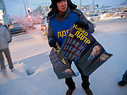 Student as campaign volunteer for the Russian Liberal Democratic Party handing out posters with the portrait of Vladimir Schirinowski a few days before the Duma elections. Yakutsk is a city in the Russian Far East, located about 4 degrees (450 km) below the Arctic Circle. It is the capital of the Sakha (Yakutia) Republic (formerly the Yakut Autonomous Soviet Socialist Republic), Russia and a major port on the Lena River. Yakutsk is one of the coldest cities on earth, with winter temperatures averaging -40.9 degrees Celsius.