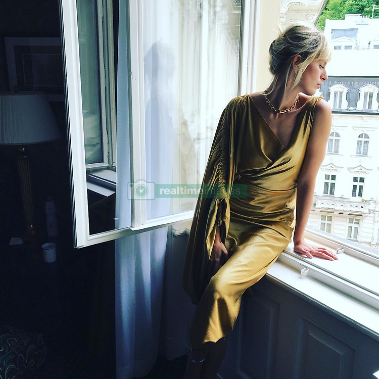 "Karolina Kurkova releases a photo on Instagram with the following caption: ""Day dreaming #karlovyvary @kviff #czechrepublic"". Photo Credit: Instagram *** No USA Distribution *** For Editorial Use Only *** Not to be Published in Books or Photo Books ***  Please note: Fees charged by the agency are for the agency's services only, and do not, nor are they intended to, convey to the user any ownership of Copyright or License in the material. The agency does not claim any ownership including but not limited to Copyright or License in the attached material. By publishing this material you expressly agree to indemnify and to hold the agency and its directors, shareholders and employees harmless from any loss, claims, damages, demands, expenses (including legal fees), or any causes of action or allegation against the agency arising out of or connected in any way with publication of the material."
