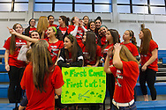 The girls' soccer team of Calhoun High School gathers for a photo while volunteering at the school's St. Baldrick's head shaving event. Calhoun exceeded its goal of raising $50,000 for childhood cancer research. Team building is another benefit of the event, and several Calhoun sports teams volunteer. Plus, many ponytails cut off will be donated to Locks of Love foundation, which collects hair donations to make wigs for children who lost their hair due to medical reasons.