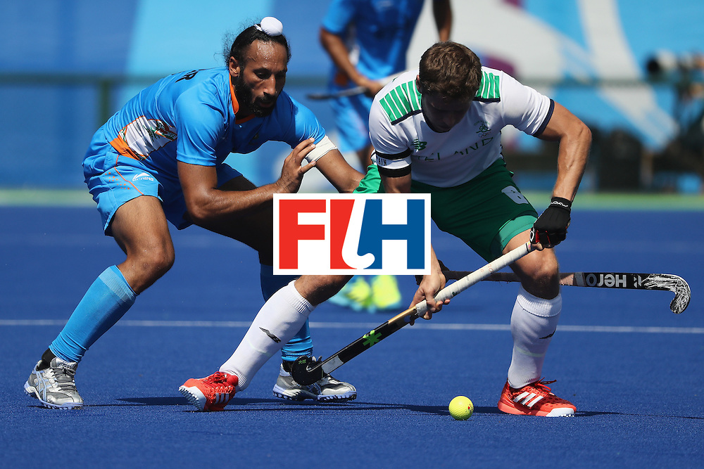 RIO DE JANEIRO, BRAZIL - AUGUST 06:  Sardar Singh #8 of India defends against Shane O'Donoghue #16 of Ireland during a Pool B match between Ireland and India on Day 1 of the Rio 2016 Olympic Games at the Olympic Hockey Centre on August 6, 2016 in Rio de Janeiro, Brazil.  (Photo by Sean M. Haffey/Getty Images)