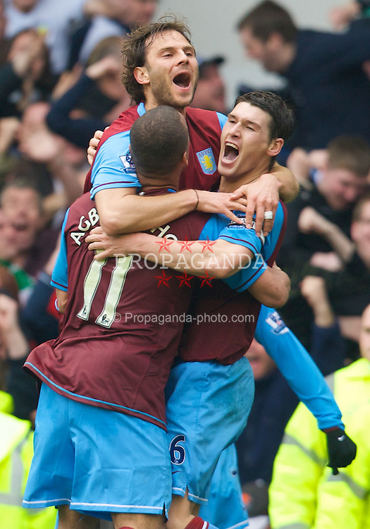 LIVERPOOL, ENGLAND - Sunday, April 27, 2008: Aston Villa's Patrik Berger, Gareth Barry and Gabriel Agbonlahor celebrate John Carew's late equaliser to make it 2-2 during the Premiership match at Goodison Park. (Photo by David Rawcliffe/Propaganda)