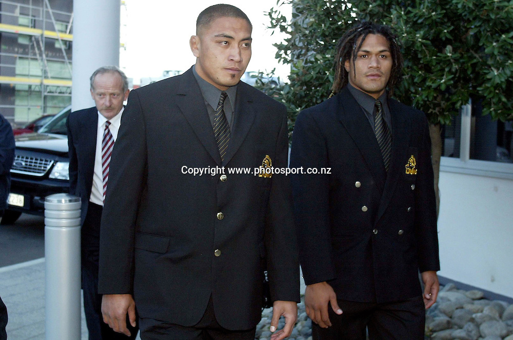 Lion's Jerry Collins with captain Rodney So'oialo (R) and lawyer Tim castles following behind head into the NZRU HQ in Wellington on Wednesday for a judiciary hearing for his high tackled last Saturday night. 13 October 2004 NZRU Wellington, New Zealand.<br />