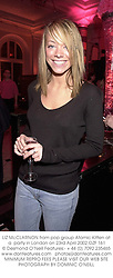 LIZ McCLARNON from pop group Atomic Kitten at a  party in London on 23rd April 2002.OZF 161